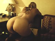Fucking her from behind while leaned over stool